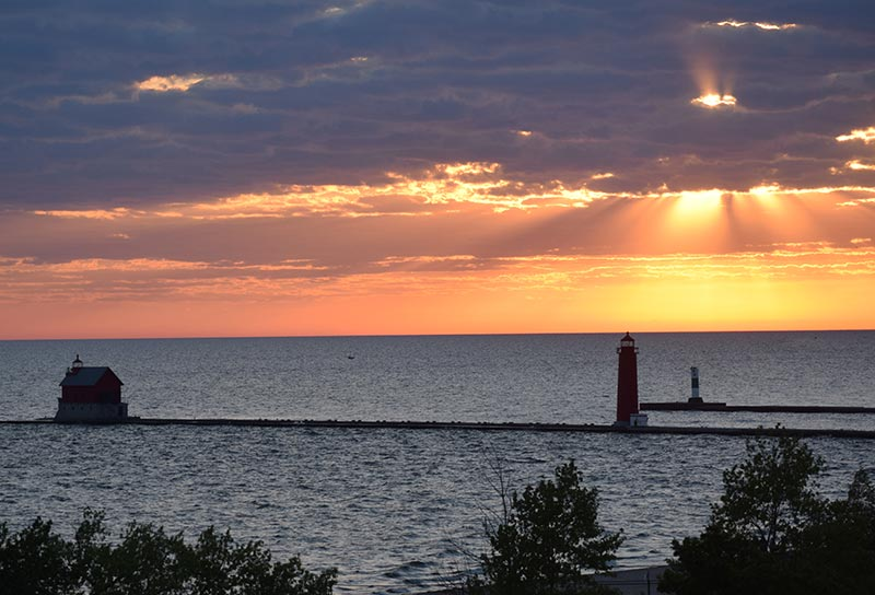 Sunset, Looking Glass Beachfront Inn Grand Haven, Michigan Beachfront Inn pier lighthouse